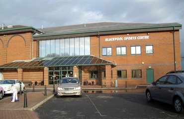 Red brick building with sign Blackpool Sports Centre.