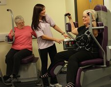 Active Blackpool Instructor in the feel good factory helping out a member