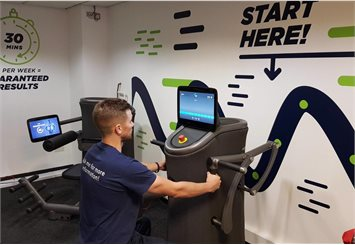 Member of staff using the express fitness equipment