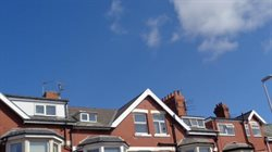 Differently designed roof lifts on a single terraced houses.
