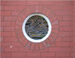 Fig. 13 Porthole window with pictorial leaded glass on Beech Avenue