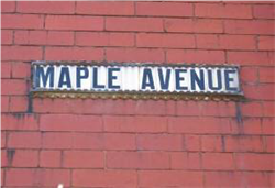 Fig. 19 Early 20th century street name signage, tiled letters in cast-iron frame