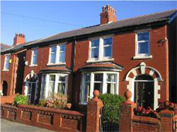 Fig. 22 Intact decorative brick boundary walls and gatepiers with terracotta details, Longton Road