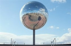 Giant mirror ball on seafront.