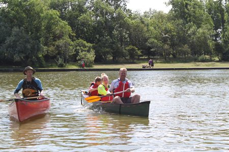 two adults and 2 children canoeing