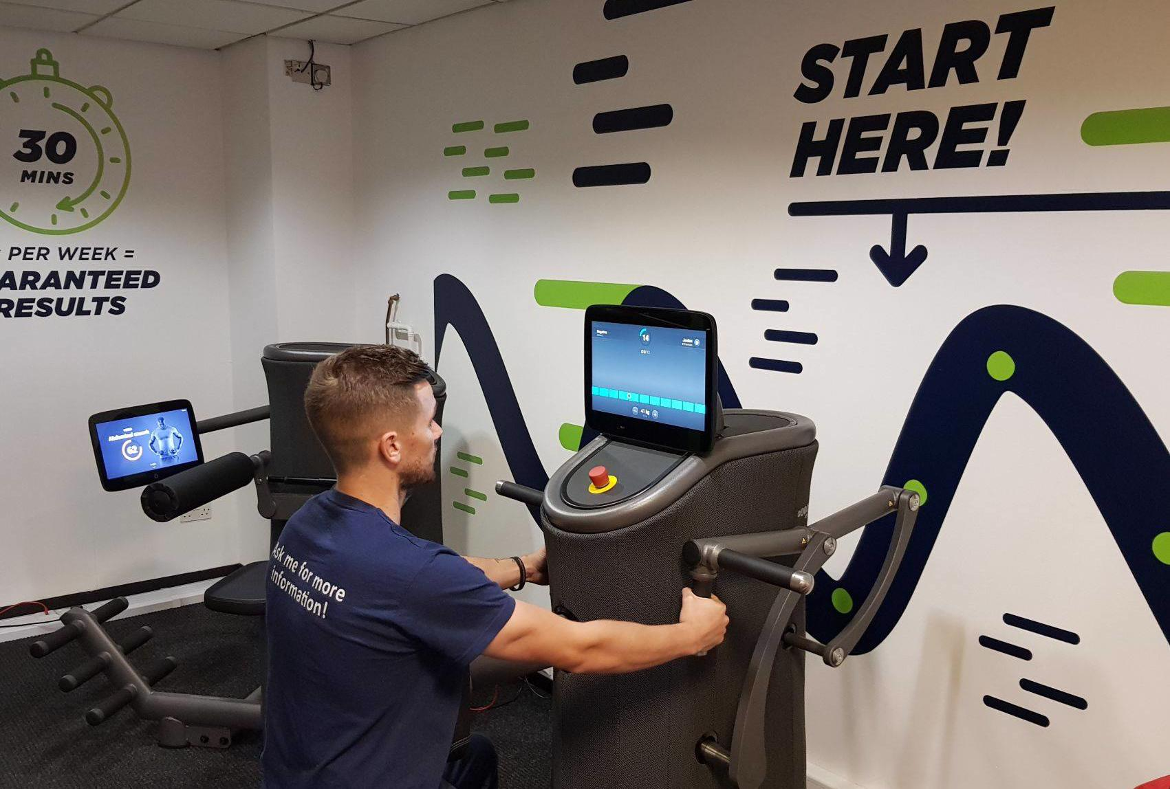 Instructor Jordan using the Express Fitness equipment
