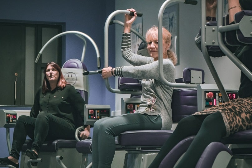 Woman sat on exercise equipment