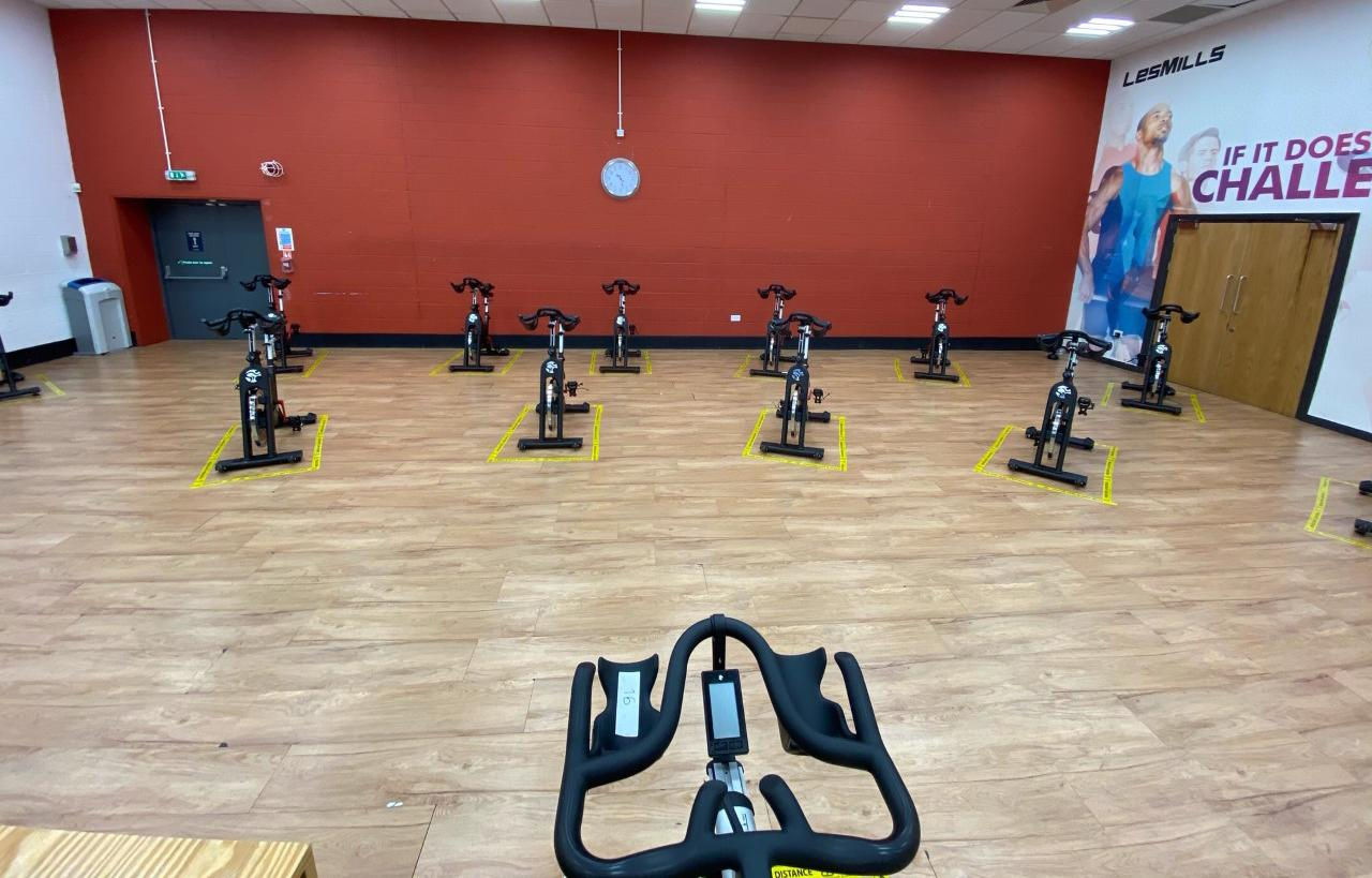 View from the spin instructors seat looking at spin bikes socially distanced