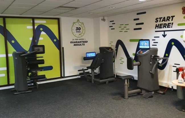 Fitness room and three pieces of equipment