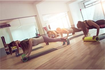 Women in a press up position during an excercise class
