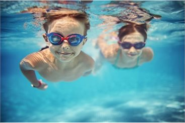 Two children swimming